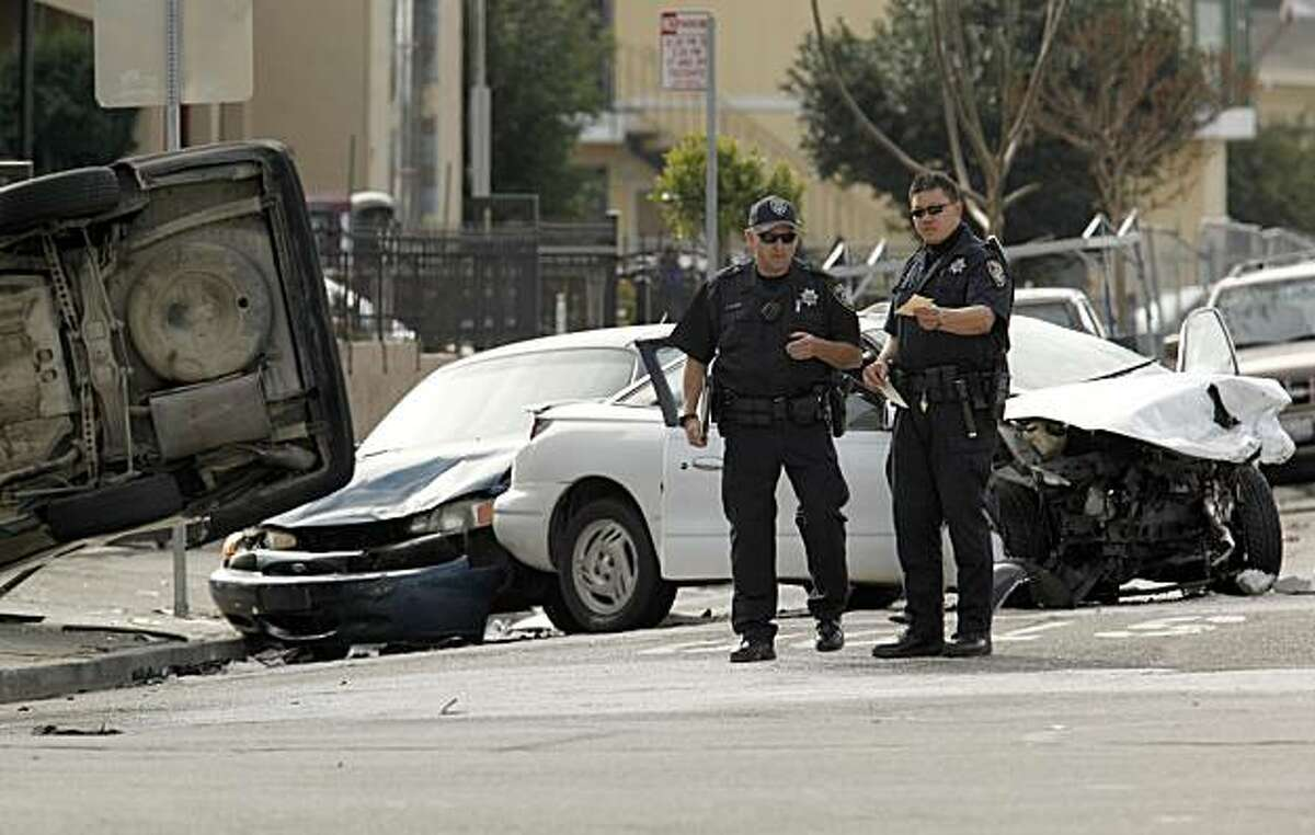 Oakland Police chased a vehicle traveling at a high rate of speed at about 10:30 am this morning, which ended as a three vehicle accident, with a 63 year old woman traveling as a passenger in the white car being killed and the suspect's vehicle overturned, at the corner of 62nd Ave. and Foothill Blvd., in Oakland, Ca. on Thursday December 31,2009.