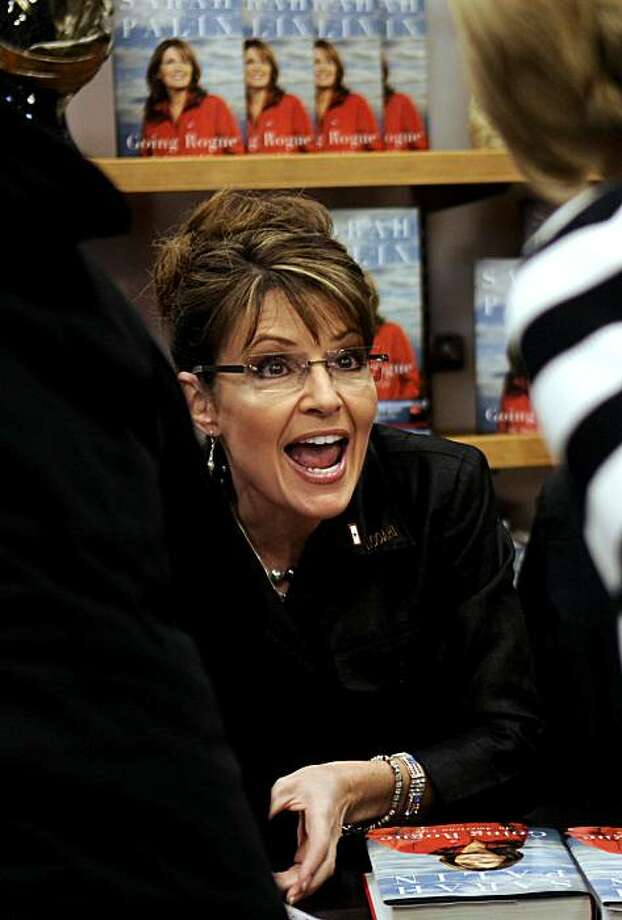 Sarah Palin greets one of her fans during her book signing in Coeur d'Alene, Idaho on Thursday, Dec. 10, 2009. (AP Photo/The Spokesman-Review, Kathy Plonka) ** COEUR D'ALENE OUT; MAGS OUT; TELEVISION OUT; NO SALES ** Photo: Kathy Plonka, AP