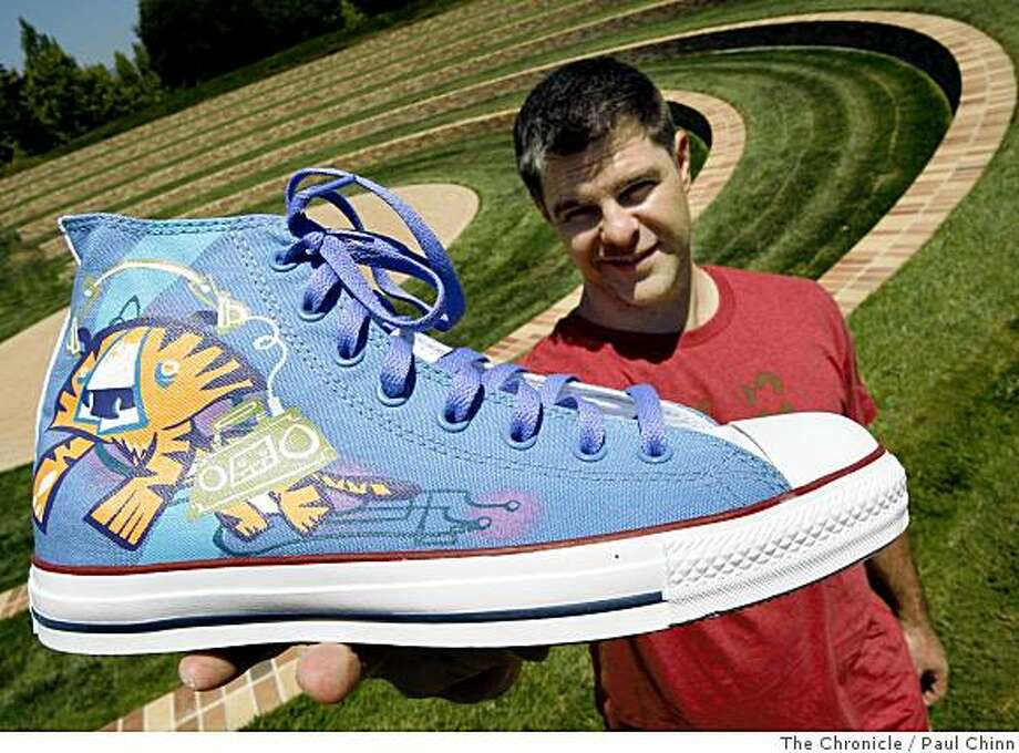 Graphic artist Scott Morse displays one of the two sneaker designs he created for the Converse shoe company in Emeryville, Calif., on Thursday, July 17, 2008. Converse marketed and sold Morse's designs overseas.Photo by Paul Chinn / The Chronicle Photo: Paul Chinn, The Chronicle