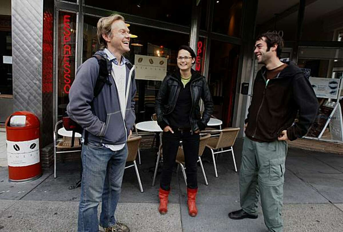 Thomas Vogl (left) stops on Irving at 7th Ave. is joined by Adam Greenfield (right) and Jennifer Kendzior (middle), while walking 2 hours to his accounting job, from the outer sunset to SOMA in San Francisco in November.
