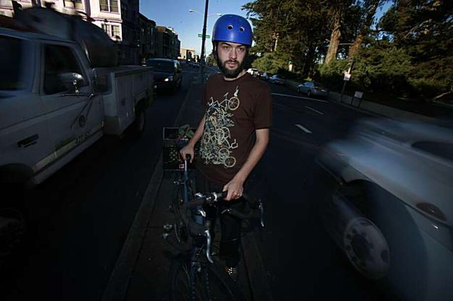 Adam Greenfield of San Francisco, who pledged to live car free in 2009, is seen with his bicycle in San Francisco. Photo: Lea Suzuki, The Chronicle