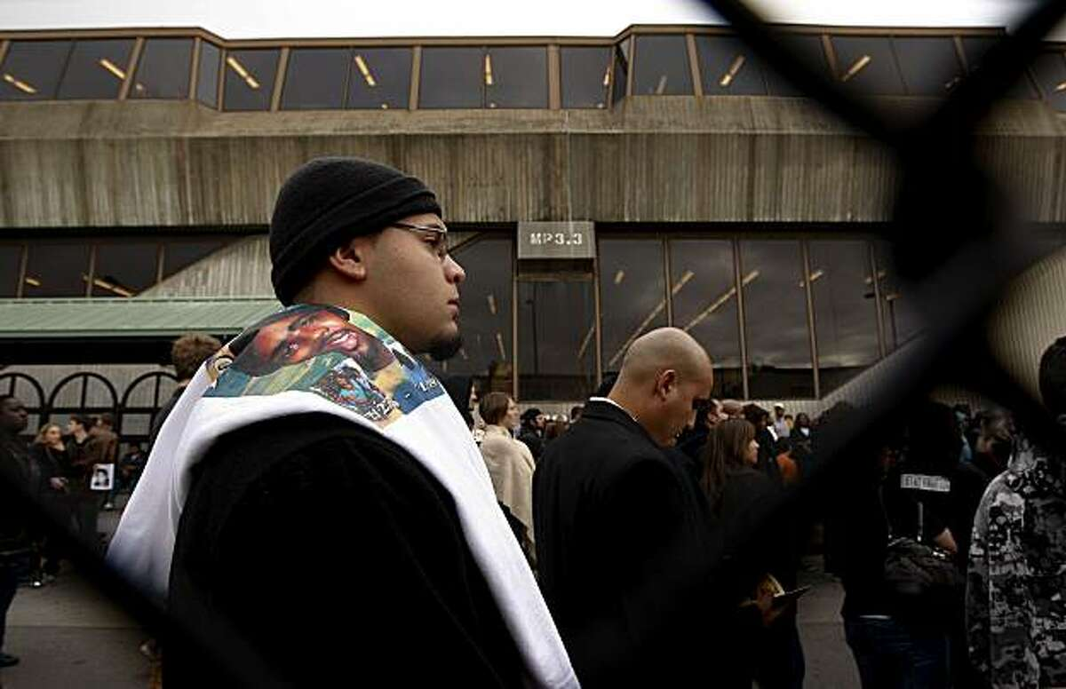 John Pangelina, joins a crowd of family, friends and supporters, gathered at the Fruitvale BART station in Oakland, Ca., for a vigil as he remembers his cousin, Oscar Grant on Friday January 1, 2010, who shot and killed on the BART platform above, early New Years Day 2009.