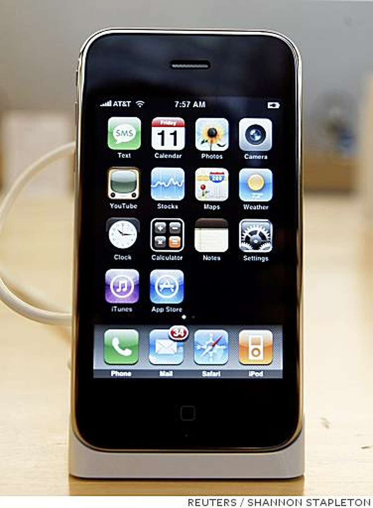 The new iPhone 3G is seen at the Apple Store in New York July 11, 2008. The new iPhone is expected to attract hordes of buyers when it goes on sale on Friday in more than 20 countries and regions, helping Apple Inc. handily beat its target to sell 10 million of them by the end of 2008. REUTERS/Shannon Stapleton (UNITED STATES)