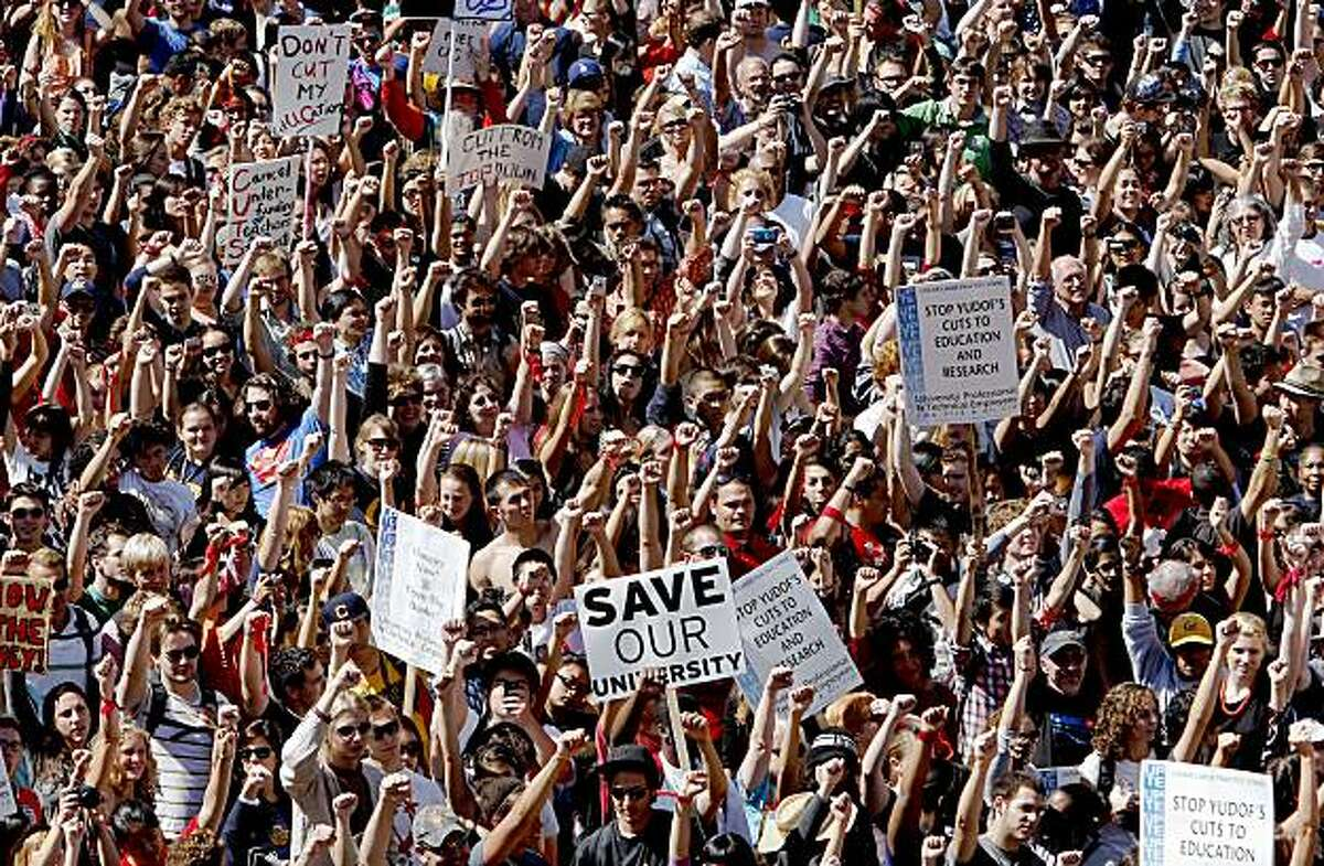 Hundreds of students and faculty hold a rally at Sproul Plaza on the UC Berkeley campus as they stage a walkout in protest of recent budget cuts and fee hikes Wednesday.