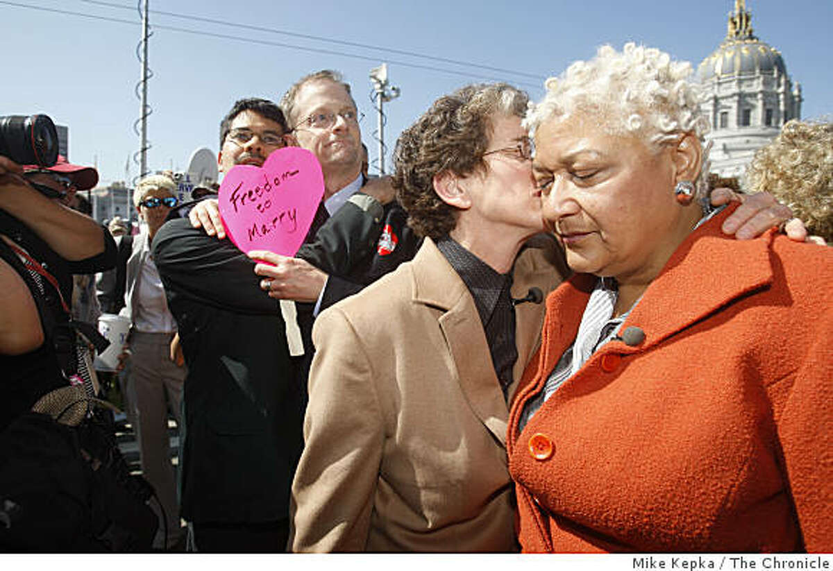 """Stuart Gaffney and John Lewis and Diane Sabin and Jewelle Gomez, the former plaintiffs in the case for same-sex marriage, react to California Supreme Court decision outside the California Supreme Court in San Francisco. The judges decided to uphold Prop. 8 but to allow same same-sex marriages from 2008 to still be valid. """" We're deeply disappointed. Democracy is not about the tyranny of the majority,"""" said Sabin."""