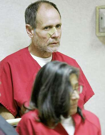 Phillip Garrido and his wife, Nancy, are seen during a bail hearing, on charges related to the 1991 abduction of Jaycee Dugard,  at the El Dorado County Superior Court in Placerville, Calif., Monday, Sept. 14, 2009.  Phillip Garrido, who faces 29 charges was given a $30 million bail but will continue to be kept in custody on a parole hold.  Nancy Garrido, who faces the same 29 charges, will continue to be held without bail.(AP Photo/Rich Pedroncelli) Photo: Rich Pedroncelli, AP