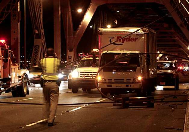 Traffic is at a standstill after the original fix for the cracked Bay Bridge eyebar snapped, spilling debris onto the westbound lanes of the Bay Bridge during the evening commute on Oct. 27, 2009. Photo: Michael Macor, The Chronicle