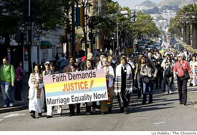 Members of Marriage Equality USA marches down Market St. from St. Francis Lutheran Church to the steps of the Supreme Court. Photo: Liz Hafalia, The Chronicle