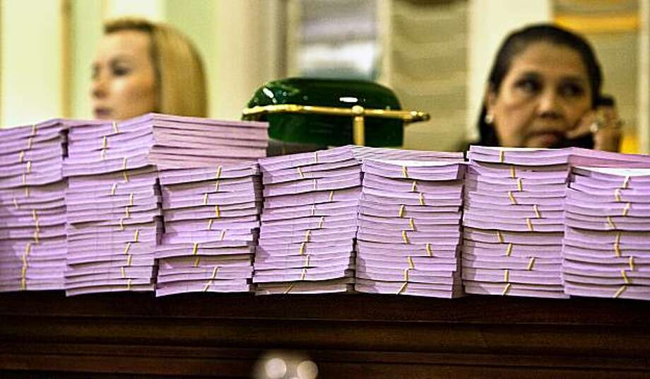A list of the bills that may be considered are ready for distribution to Assemblymembers at a clerk's desk on the floor of the Assembly September 11, 2009 in Sacramento. The state Senate and Assembly are voting on hundreds of bills, trying to beat a midnight end of session deadline. Photo: Robert Durell, Special To The Chronicle