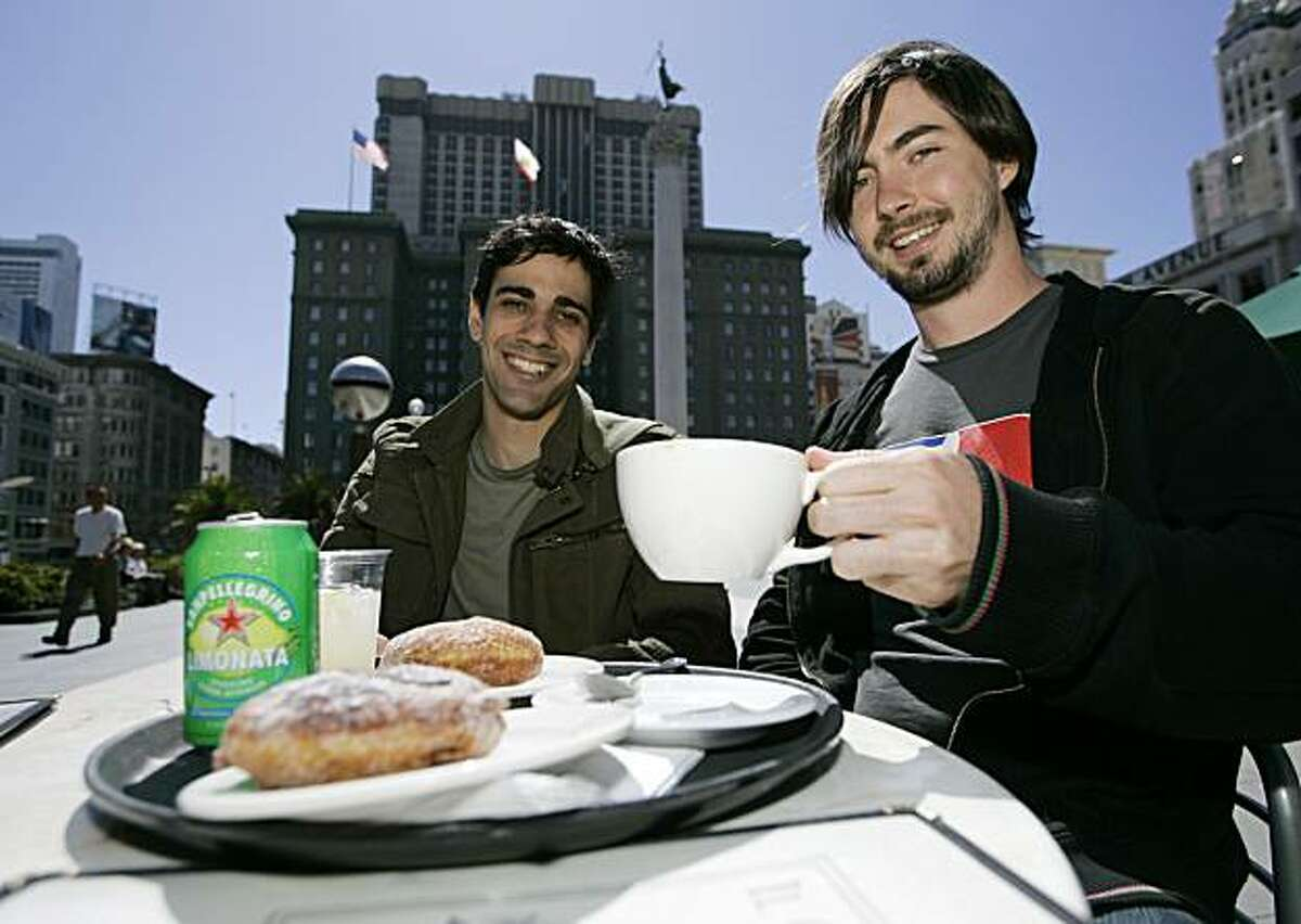 Jeremy Stoppelman, left, and Russel Simmons, right, co-founders of Yelp.com try the food at a cafe on Union Square in San Francisco, Calif., Monday, June 25, 2007. (AP Photo/Eric Risberg)
