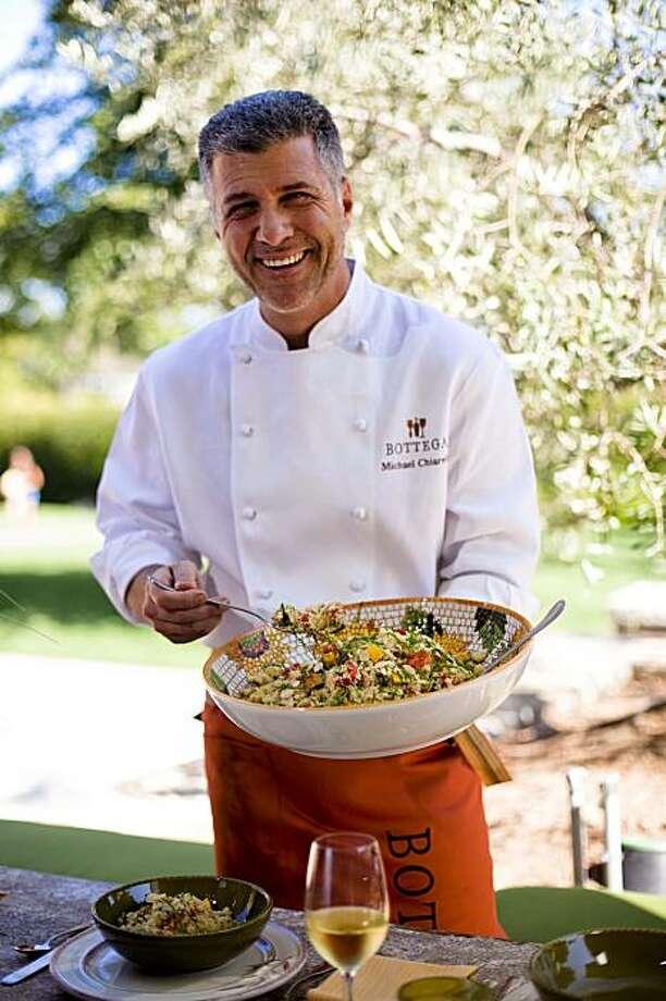 Michael Chiarello serving his couscous salad with warm honey vinaigrette at Bottega Ristorante in Yountville, Calif. on Thursday, Aug. 20, 2009. Photo: Stephen Lam, The Chronicle