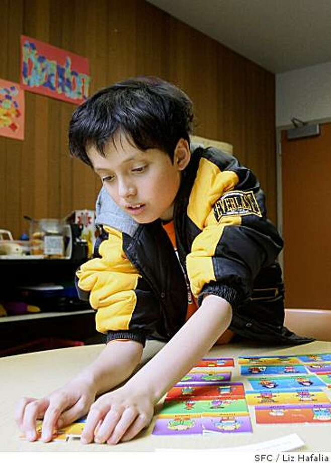 Jonah Kasoff, an 11 year old autistic child puts together opposite puzzles at Yick Wo elementary school in San Francisco, CA, on Monday, Feb. 25, 2008. There is a rise in autistic children in California schools. Photo by Liz Hafalia/ San Francisco Chronicle Photo: Liz Hafalia, SFC