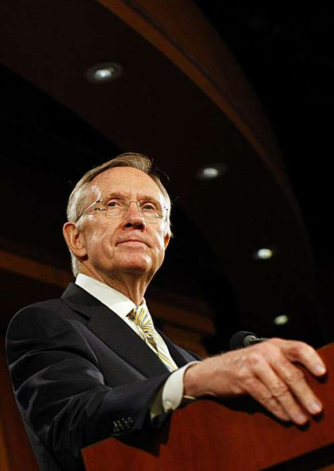 Senate Majority Leader Harry Reid (D-Nev.) pauses while speaking to reporters in Washington on Monday,Oct. 26, 2009. Reid said health care legislation headed to the Senate floor will include an option for government-run insurance. (Luke Sharrett/The New York Times) Photo: Luke Sharrett, NYT