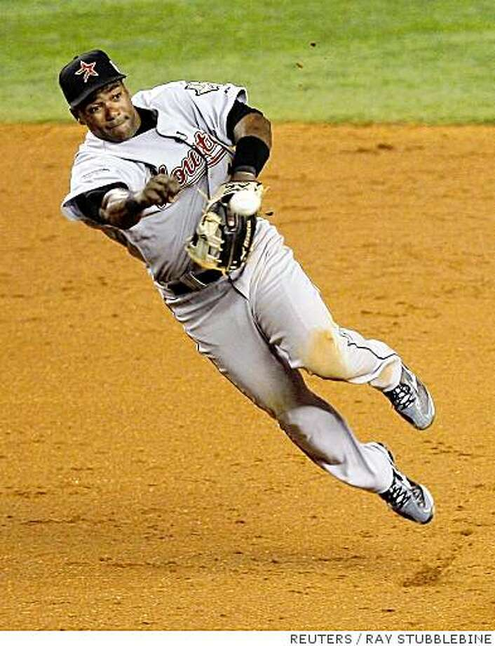 National Leagues' Miguel Tejada of the Houston Astros makes the throw to first base to make the final out in the 10th inning. Reuters photo by Ray Stubblebine Photo: RAY STUBBLEBINE, REUTERS