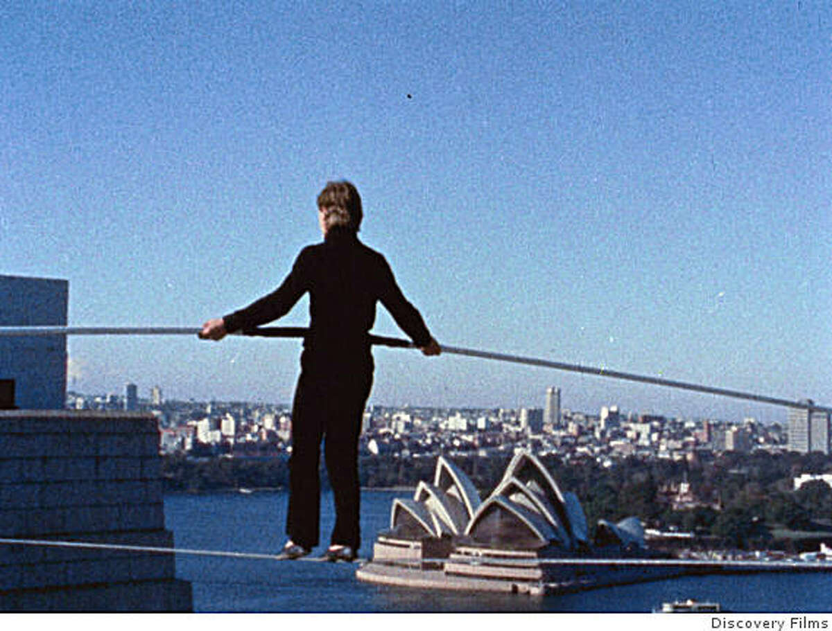 Still from movie MAN ON WIRE, shows Philippe Petit walking a tightrope in Sydney, Australia.