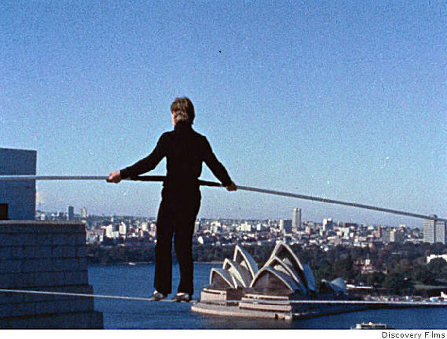 Still from movie MAN ON WIRE, shows Philippe Petit walking a tightrope in Sydney, Australia. Photo: Discovery Films
