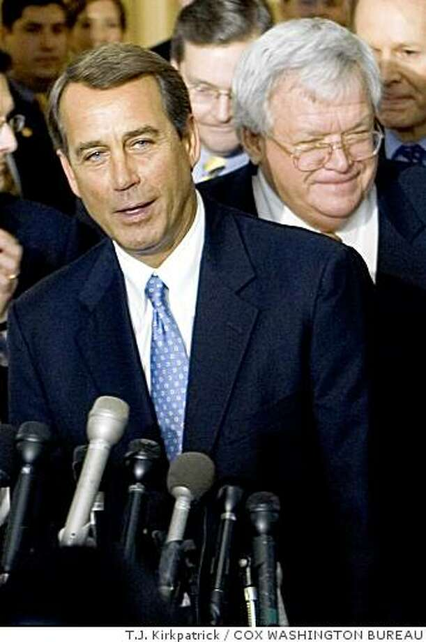 Photo by: T.J. KIRKPATRICK/COX WASHINGTON BUREAU slug: HOUSE-LEADER03 WASHINGTON--Rep. John Boehner, R-Ohio, left, talks with the media after being named House Majority Leader in an upset GOP leadership election Thursday, Feb. 2, 2006. With Boehner is Speaker of the House Dennis Hastert, R-Ill. (T.J. KIRKPATRICK/COX WASHINGTON BUREAU)Ran on: 02-03-2006 Photo: T.J. Kirkpatrick, COX WASHINGTON BUREAU