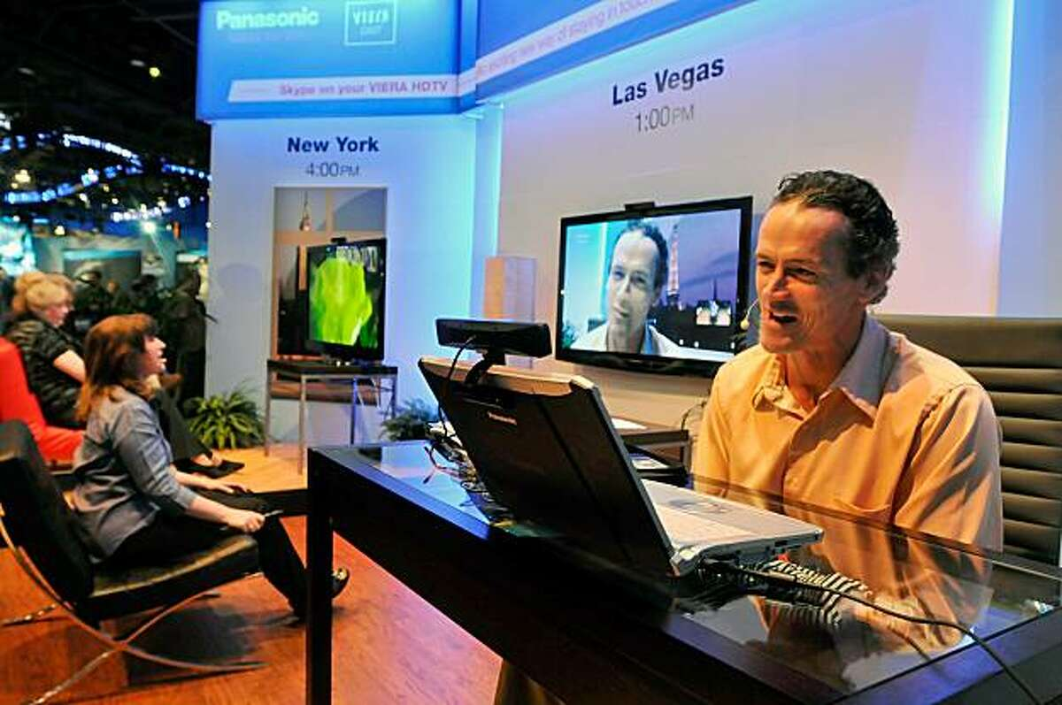 LAS VEGAS - JANUARY 07: Actor Jack Brand (R), participates in a Skype call using a laptop computer and one of Panasonic's Viera Cast enabled HDTV televisions at the 2010 International Consumer Electronics Show at the Las Vegas Convention Center January 7, 2010 in Las Vegas, Nevada. CES, the world's largest annual consumer technology tradeshow, runs through January 10 and is expected to feature 2,500 exhibitors showing off their latest products and services to about 110,000 attendees.