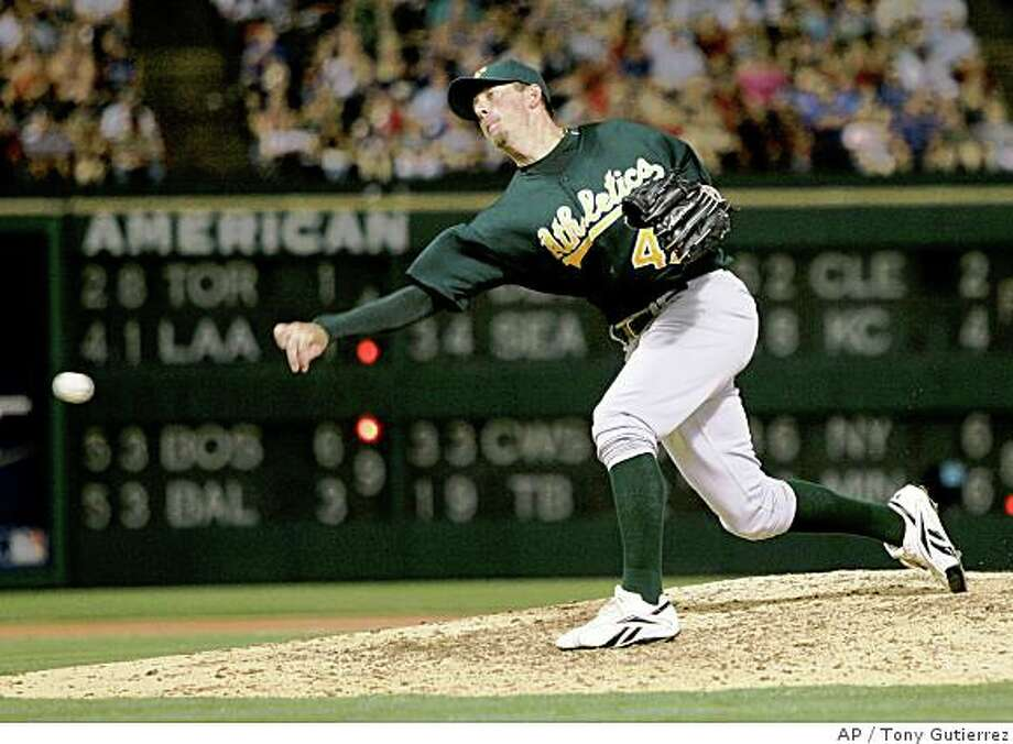Oakland Athletics relief pitcher Brad Ziegler delivers to the Texas Rangers in his major league debut in a baseball game, Saturday, May 31, 2008, in Arlington, Texas. The Rangers won 8-4. (AP Photo/Tony Gutierrez) Photo: Tony Gutierrez, AP