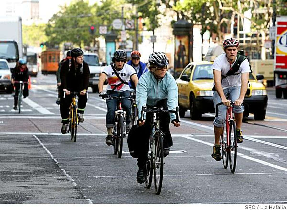 Cyclists biking along Market Street at Grant Ave. in San Francisco, Calif., on Monday, May 9, 2008. Photo by Liz Hafalia / San Francisco Chronicle