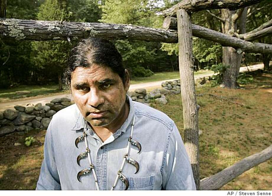 **APN ADVANCE FOR SUNDAY JULY 20** John Brown, the historic preservation officer for the Narragansett American Indian tribe, appears on Narragansett tribal land, in southern Rhode Island, Tuesday, July 1, 2008. Brown said the hundreds of rock mounds near Nipsachuck Hill and swamp, in North Smithfield, R.I., appear manmade and probably mark a burial or ceremonial ground common to several tribes. (AP Photo/Steven Senne) Photo: Steven Senne, AP