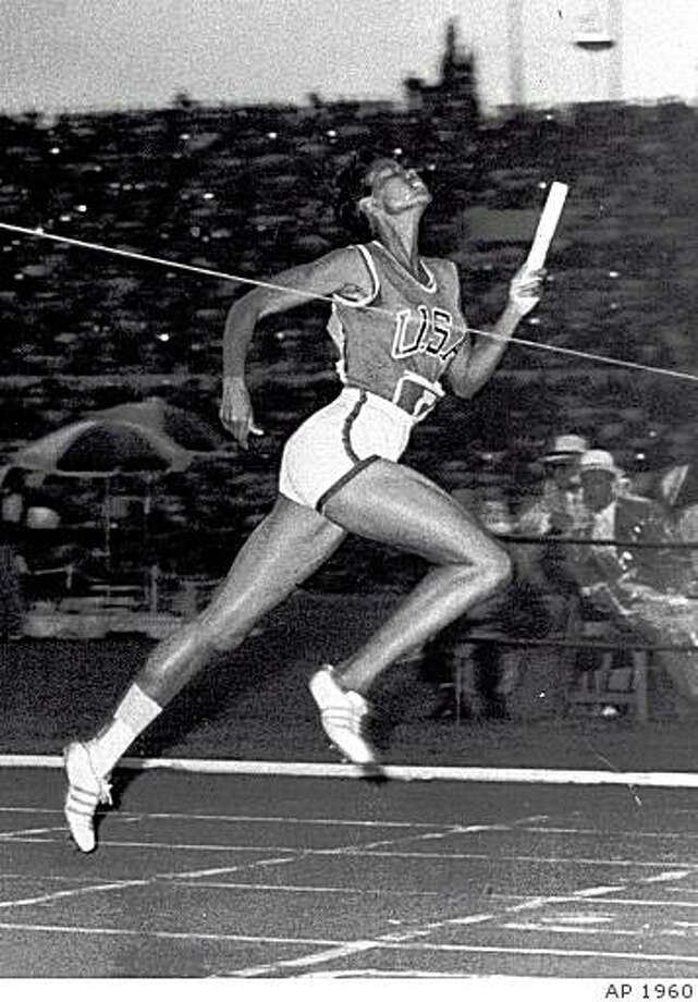 ADVANCE FOR WEEKEND JUNE 22-23--FILE--Wilma Rudolph, 20, hits the tape to win the 400 meter relay for the US at the 1960 Summer Olympics in Rome. (AP Photo/file) Photo: AP 1960, Associated Press