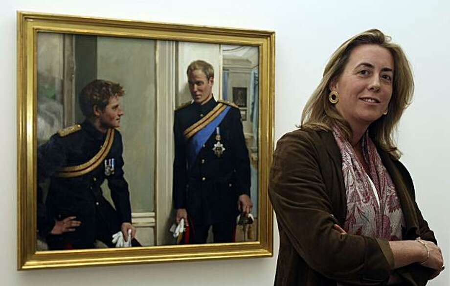 Artist Nicky Philipps poses with her new double-portrait of Britain's Princes William and Harry, after it was unveiled at the National Portrait Gallery in London, Wednesday Jan. 6, 2010. The National Portrait Gallery commissioned the painting of the two royals, wearing the dress uniform of the Blues and Royals, one of the regiments of the Household Cavalry, in the setting of Clarence House, the home of their father, Prince Charles. Photo: Alastair Grant, AP