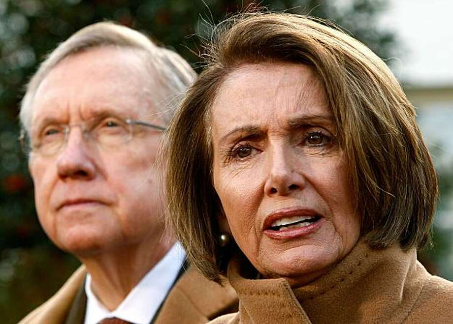 WASHINGTON - DECEMBER 09:  U.S. Speaker of the House Rep. Nancy Pelosi (D-CA) (R) speaks to the media as Senate Majority Leader Sen. Harry Reid (D-NV) (L) listens after a meeting with President Barack Obama December 9, 2009 at the White House in Washington, DC. Obama had a bipartisan meeting with members of Congress to discuss job creation and economic growth.  (Photo by Alex Wong/Getty Images) Photo: Alex Wong, Getty Images