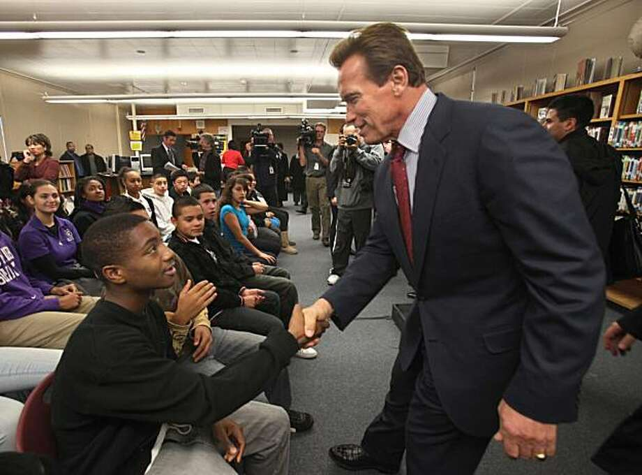 Gov. Arnold Schwarzenegger shakes hands with eighth grader Daquan Scott, 14, following his remarks at the Rosa Parks Middle School, in Sacramento, Calif., Tuesday, Jan. 5, 2010.  Schwarzenegger visited the school where he called on lawmakers to approve a measure he is backing for federal Race to the Top education funding. California stands to qualify for up to $700 million. (AP Photo/Rich Pedroncelli) Photo: Rich Pedroncelli, AP