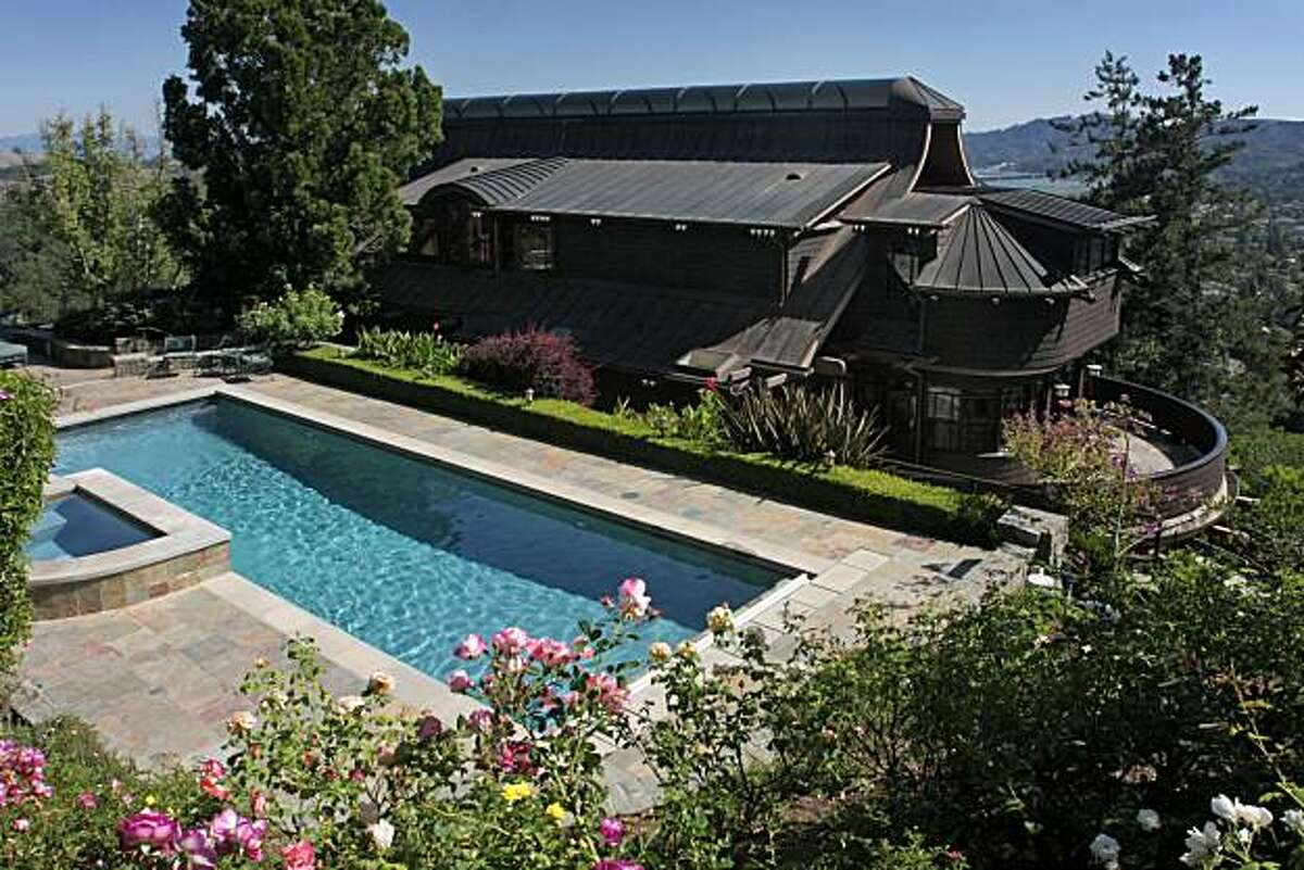 The 20,000 square foot, landscaped lot includes both a guest house and a swimming pool.