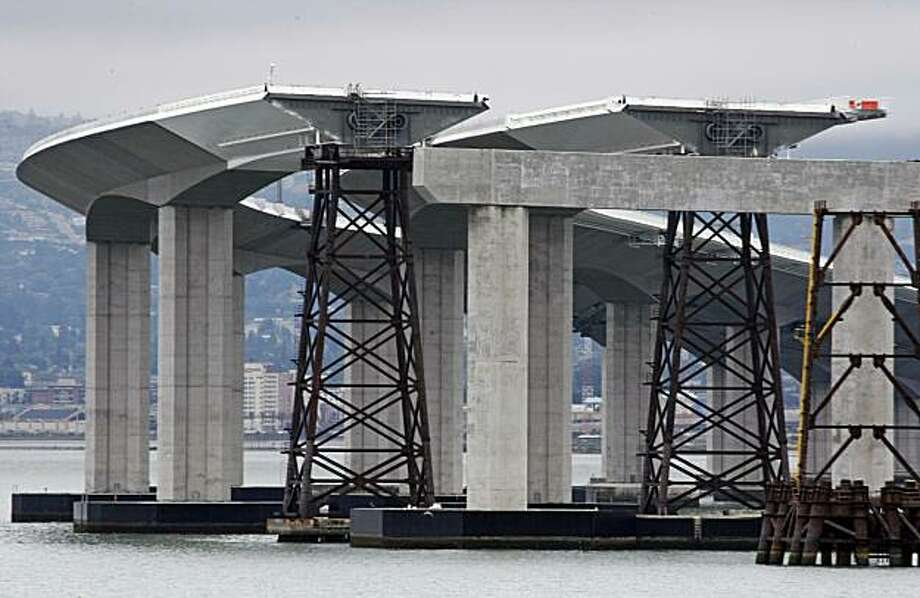 Temporary supports hold up portions of the new Skyway section of the Self-Anchored Bay Bridge under construction next to the old boxed steel frame Bridge. Photo: Lance Iversen, The Chronicle