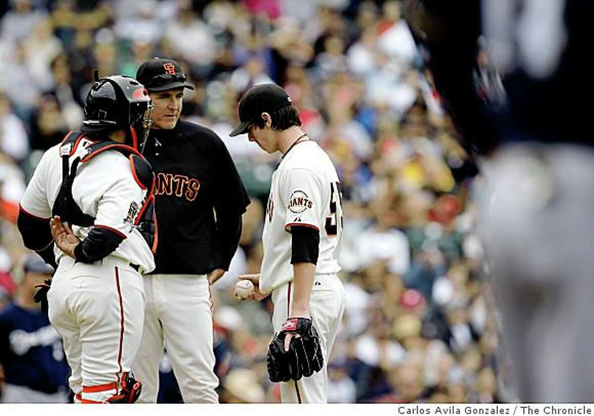 Pitching coach, Dave Righetti and Benji Molina conference with pitcher, Tim Lincecum, after Lincecum walked the bases loaded in the top of the third inning. The San Francisco Giants played the Milwaukee Brewers at AT&T Park in San Francisco, Calif., on Sunday, July 20, 2008, losing, 7-4 and were swept in the three game series.Photo by Carlos Avila Gonzalez / The Chronicle