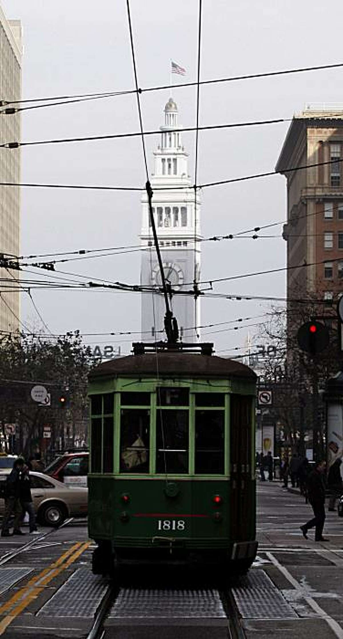 A Muni trolley makes its way down to the Ferry Building on Market Street. San Francisco's Market Street between 5th street and the Ferry Building is full of vitality and considered by most to the one of the main arteries of the city. Jan. 7, 2010