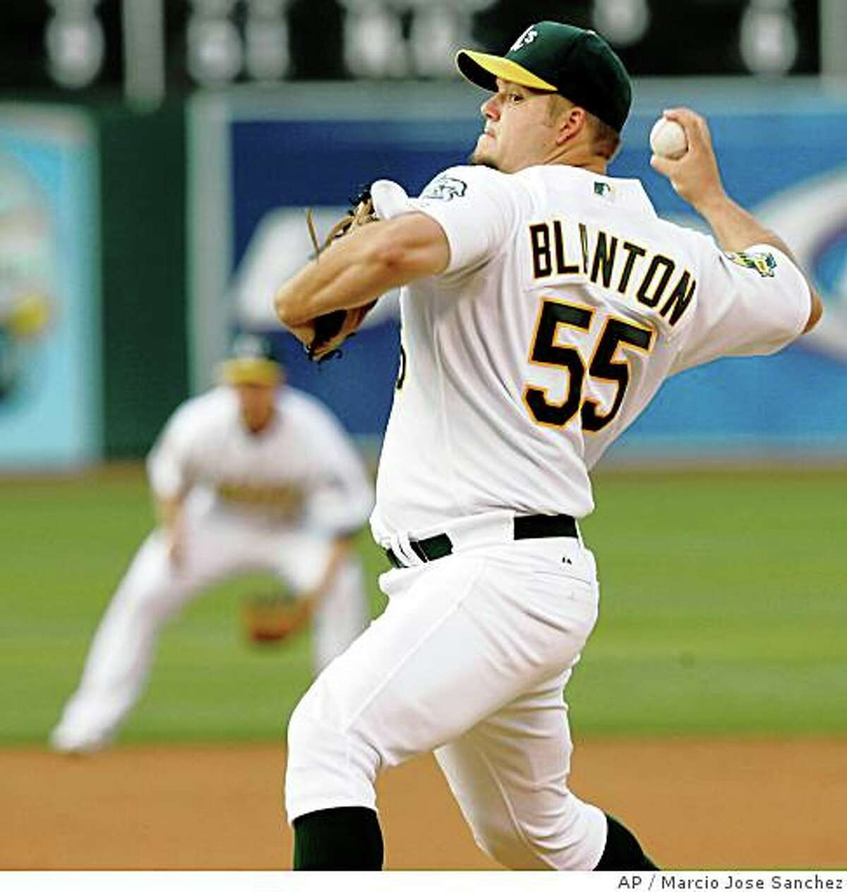 Oakland Athletics starting pitcher Joe Blanton throws to the Seattle Mariners in the first inning of a baseball game in Oakland, Calif., Wednesday, July 9, 2008. (AP Photo/Marcio Jose Sanchez)