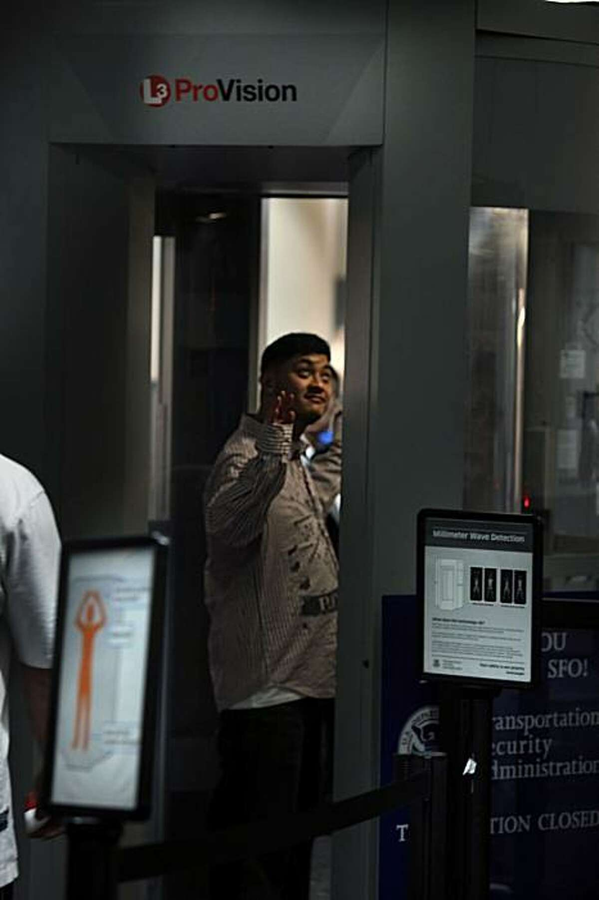 Passengers at SFO International Airport going through security screening using the Whole Body Imager (WBI) in South San Francisco, Ca., on Monday, December 28, 2009. Using millimeter wave detection the WBI is the only scanner in the bay area which SFO has been using since nine months ago.