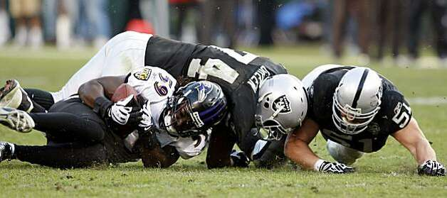 The Baltimore Ravens' Dannell Ellerbe recovers a fumble by Oakland Raiders quarterback JaMarcus Russell in the fourth quarter Sunday in Oakland. Photo: Lacy Atkins, The Chronicle