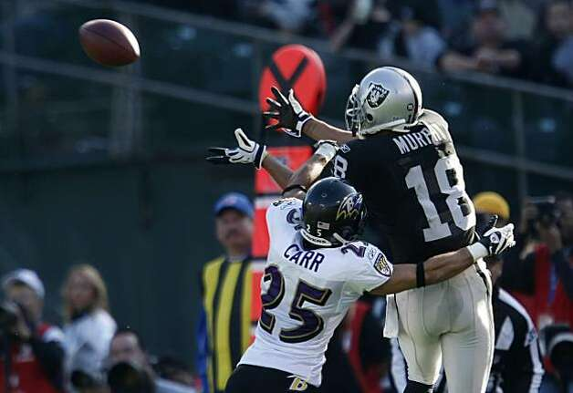The Oakland Raiders' Louis Murphy catches a first down pass in the second quarter against the Baltimore Ravens on Sunday in Oakland. Photo: Lacy Atkins, The Chronicle