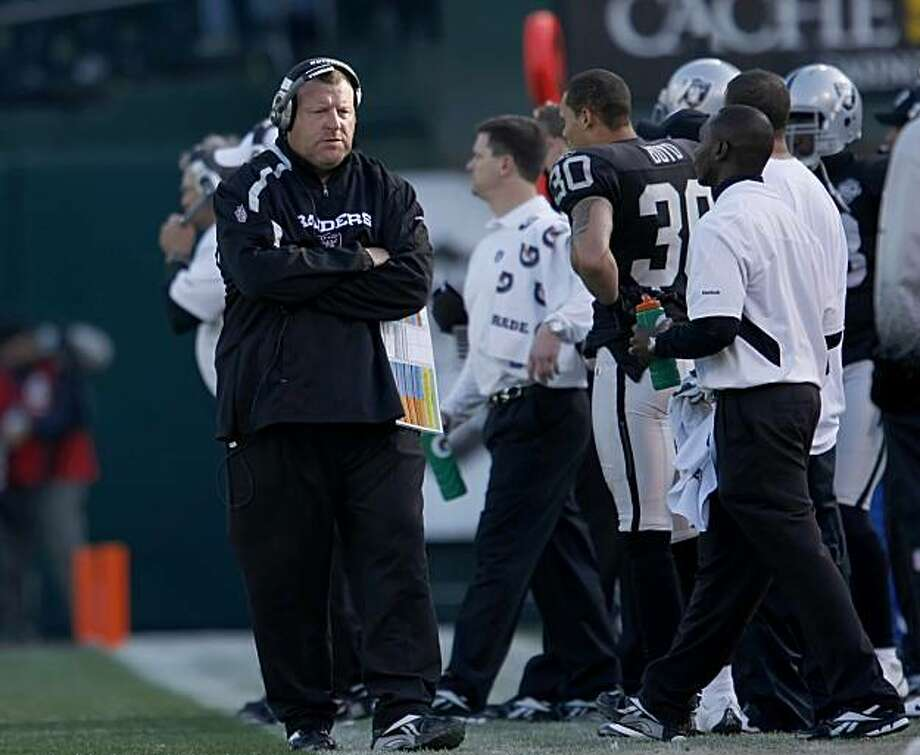 Oakland Raiders head coach Tom Cable walks the sidelines in the game against the Baltimore Ravens on Sunday in Oakland. Photo: Lacy Atkins, The Chronicle