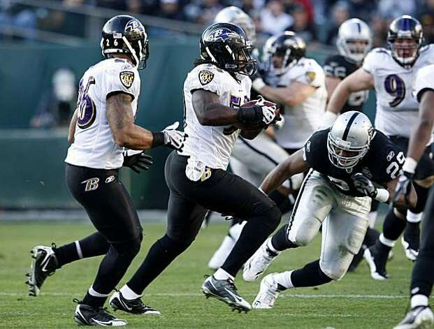 The Baltimore Ravens' Dannell Ellerbe intercepts a pass from Oakland Raiders quarterback JaMarcus Russell in the second half of the game Sunday in Oakland. Photo: Lacy Atkins, The Chronicle