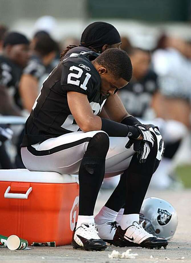 Nnamdi Asomugha sits on the bench during the Raiders game against the Baltimore Ravens in Oakland on Sunday. Photo: Jed Jacobsohn, Getty Images