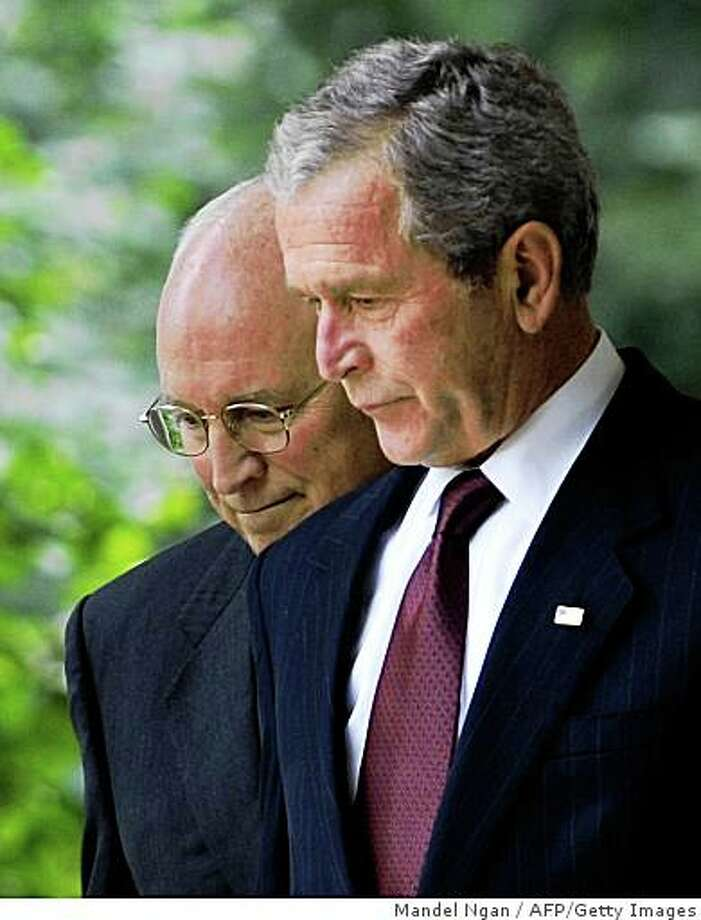 US President George W. Bush (R) and Vice President Dick Cheney walk to the Rose Garden on July 10, 2008 for Bush to sign H.R. 6304, the FISA Amendments Act of 2008, at the White House in Washington, DC. The bill would expand legal authority for electronic wiretaps by spy agencies and includes retroactive immunity for telecommunications firms which aided warrantless government surveillance operations following the September 11 attacks. AFP PHOTO/Mandel NGAN (Photo credit should read MANDEL NGAN/AFP/Getty Images) Photo: Mandel Ngan, AFP/Getty Images