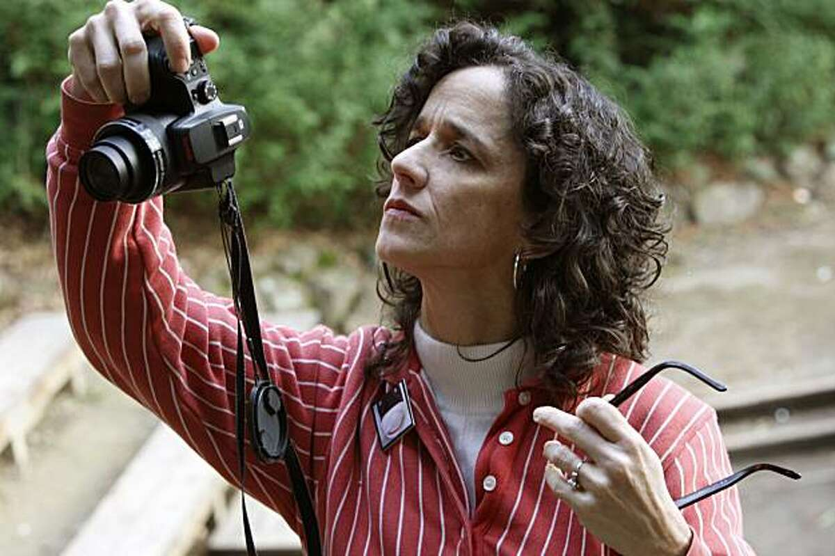 Ruth Kaiser at a park across from Village Square, as she searches for smiley faces to photograph in downtown Orinda, Ca., on Wednesday, December 30, 2009. Two years ago, Lafayette pre-school teacher Ruth Kaiser started posting photos of what she calls