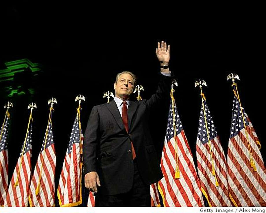 "WASHINGTON - JULY 17:  Former U.S. Vice President Al Gore waves after speaking at Daughters of the American Revolution's Constitution Hall July 17, 2008 in Washington, DC. Gore spoke on ""his bold vision for the future of America's energy needs.""  (Photo by Alex Wong/Getty Images) Photo: Getty Images"