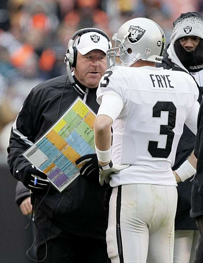 Oakland Raiders coach Tom Cable talks to quarterback Charlie Frye (3) during the first quarter of an NFL football game against the Cleveland Browns, Sunday, Dec. 27, 2009, in Cleveland. (AP Photo/Mark Duncan) Photo: Mark Duncan, AP