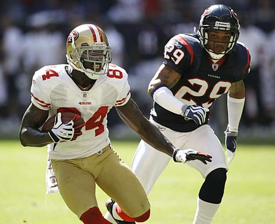 San Francisco 49ers wide receiver Josh Morgan (84) runs the ball away from Houston Texans cornerback Glover Quin (29) after making a reception during the 2nd half of an NFL football game at Reliant Stadium Sunday, Oct. 25, 2009, in Houston. The Texans beat the 49ers 24-21. ( Brett Coomer / Chronicle ) Photo: Brett Coomer, Chronicle