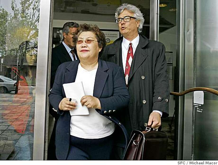 Julie Lee leaves the San Francisco County Jail Building, after turning herself in and than posting bail. Joined by her attorney Steve Gruehl. Julie Lee State, top volunteer fund-raiser for former Secretary of State Kevin Shelley, was charged by state prosecutors with grand theft and other felonies on Thursday, accusing her of diverting $125,000 from a taxpayer-funded grant to Shelley's 2002 campaign fund. 4/8/05 Oakland, Ca Michael Macor / San Francisco Chronicle Photo: Michael Macor, SFC