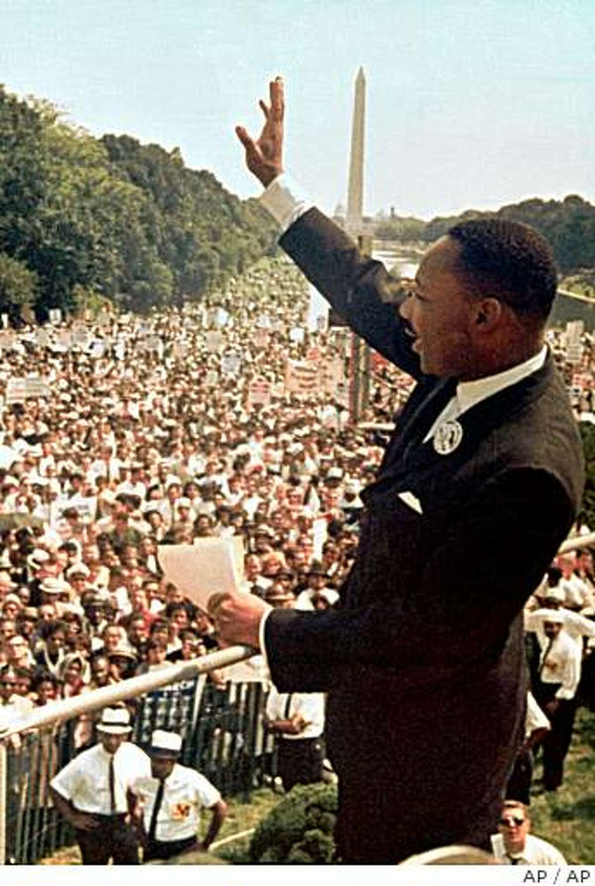 The Rev. Martin Luther King Jr. acknowledges the crowd in front of the Lincoln Memorial for his