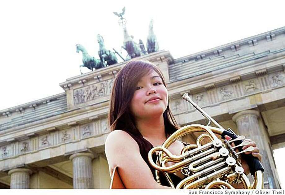 Kalyn Jang, 16, plays French horn with the San Francisco Symphony Youth Orchestra and will report on the orchestra's current European tour. She's shown above in Berlin Photo: Oliver Theil, San Francisco Symphony