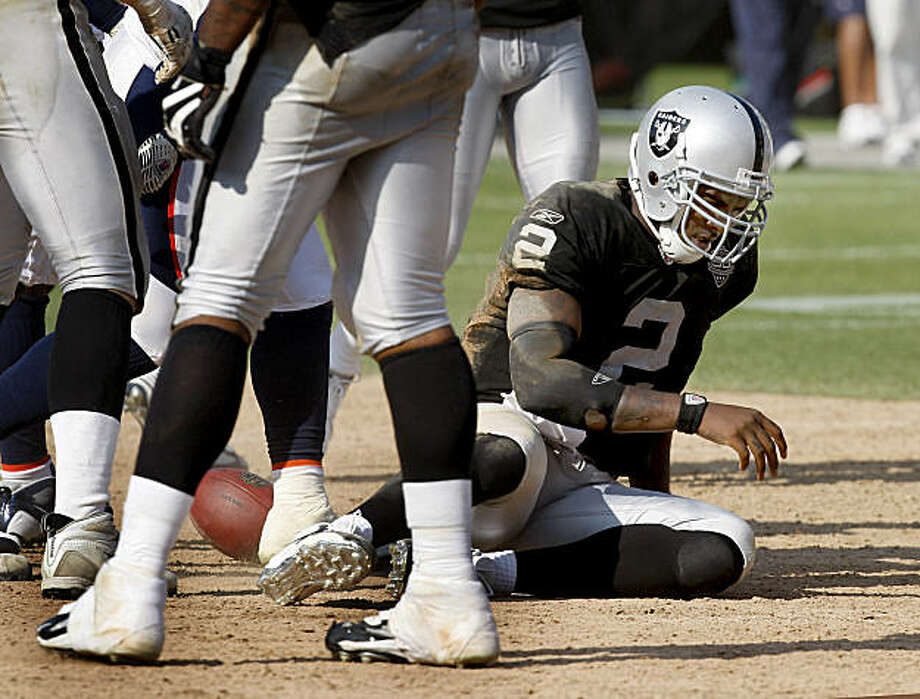 Raiders quarterback JaMarcus Russell gets to his feet after being sacked in the second half against the Broncos on Sunday. Photo: Brant Ward, The Chronicle