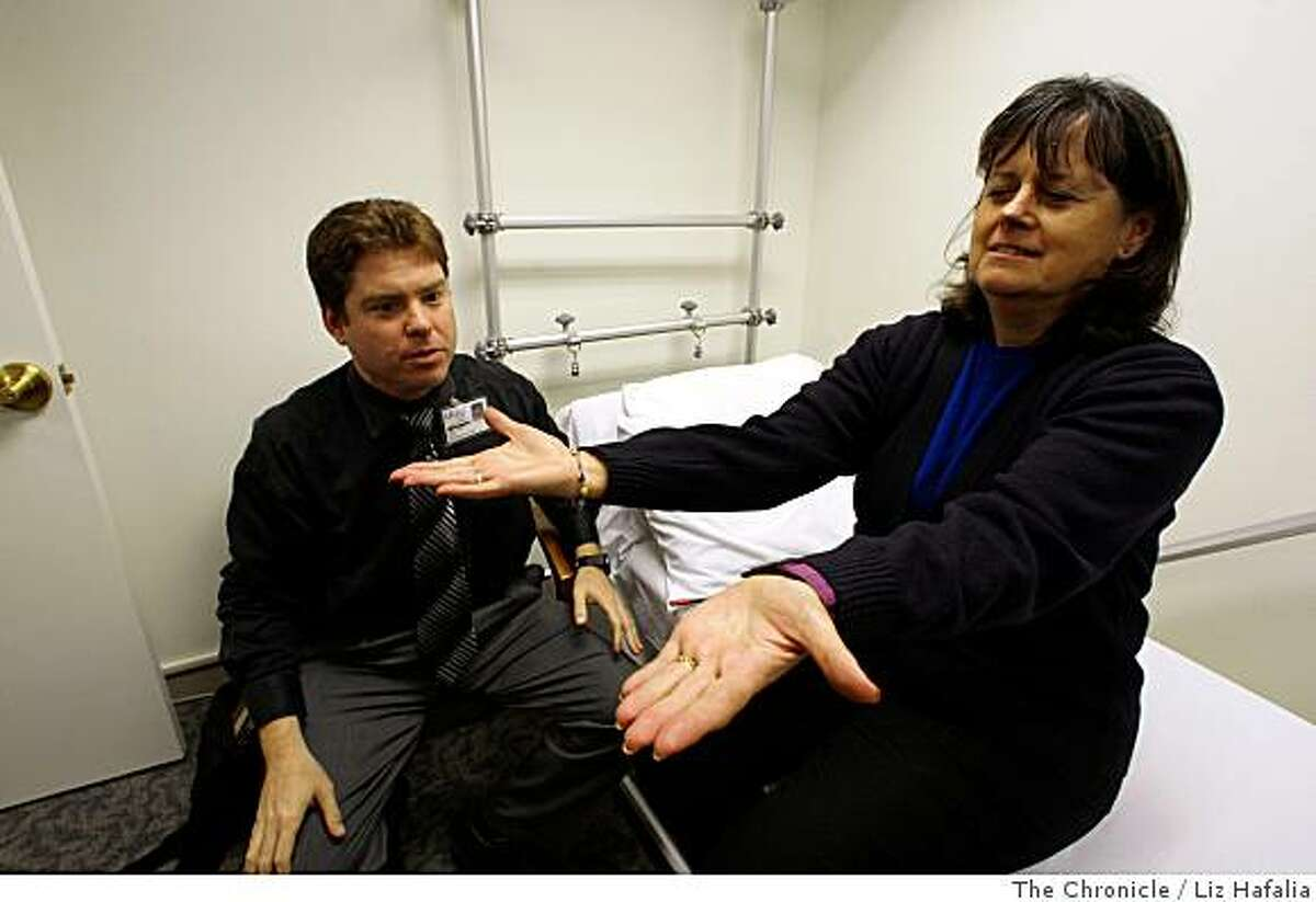 UCSF neurologist Gil Rabinovici, MD, works with patient Claudia Benedetti, 61 years old from Pacifica, who has early age of onset Alzheimer�s disease in San Francisco, Calif., on Monday, July 7, 2008.Photo by Liz Hafalia/The Chronicle